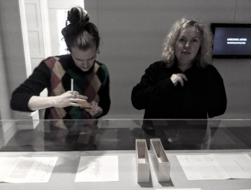 Helen Palmer and Linda Doyle reading the Aspen 5 + 6 display by OMG at IMMA